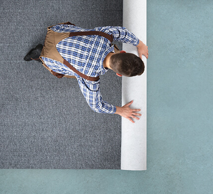 Carpet rolling for installation | Carpets And More, Inc